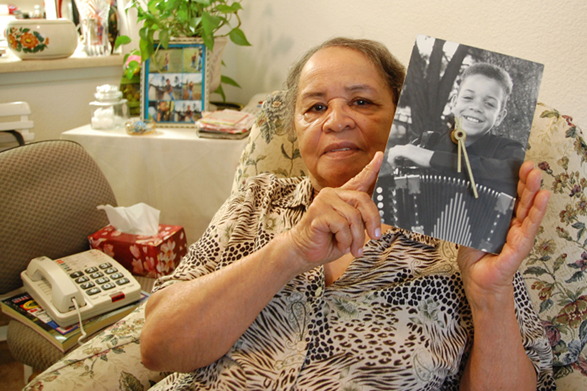 Lena Pitre, holding a picture of her grandson, Andre Thierry.